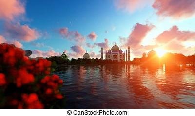 Taj Mahal against beautiful sunset, view from Yamuna River