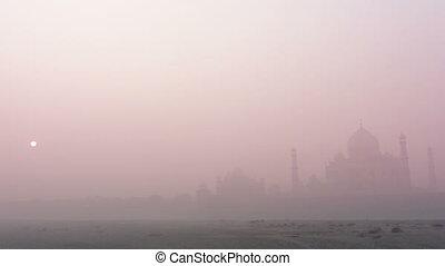 Taj Mahal at sunrise in fog - timelapse