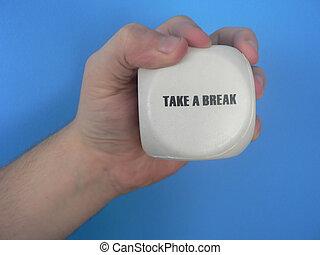 Take a break - A hand holding the message Take a break.