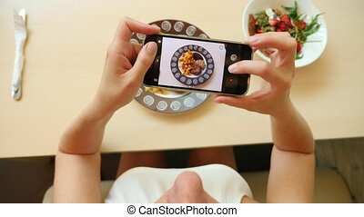 take a photo of food in a restaurant with mobile phone...