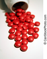 Take a Pill - Red pills dumped out from their container, ...