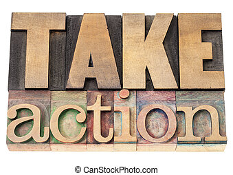 take action in wood type - take action - motivation concept...