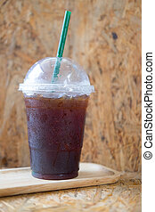 Take away plastic cup of iced black coffee americano