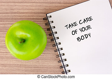 Take care of your body text on notepad - well being concept