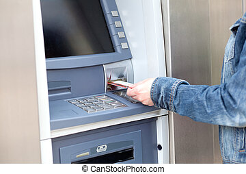 Take cash from the ATM