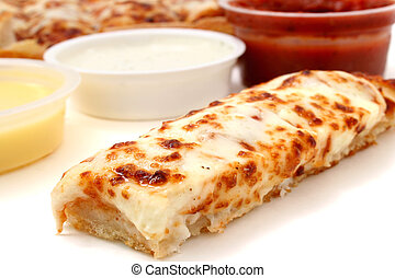 Take cheese pizza sticks with a container of marinara sauce, ranch dressing and garlic butter. Focus on pizza stick in front. Shot with the Canon 20D.