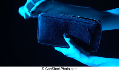 Take dollars from your wallet - A girl takes dollars out of...