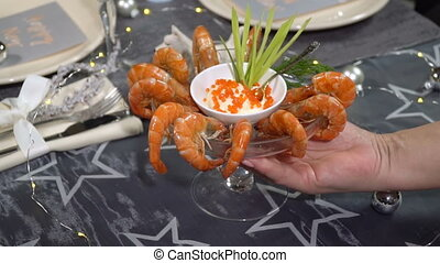 Take from the table a dish of shrimp. Slow motion - Take...