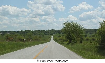 No this isnt West Virginia, but a road in Arkansas. This road curves Left, Right, Left ETC.
