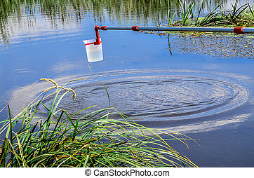 Take samples of water for laboratory testing. The concept -...