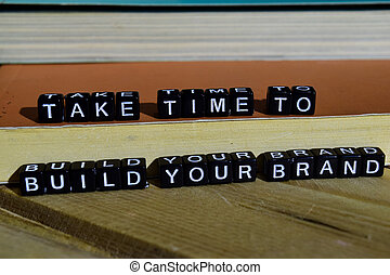 Take time to build your brand on wooden blocks.