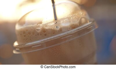 Takeaway cold coffee with straw - Close-up shot of takeaway...