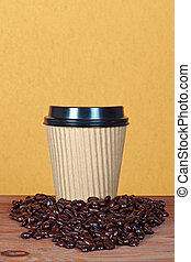 Takeaway paper coffee cup with beans