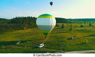 takeoff air balloon at sunset , ai balloons start fly from...