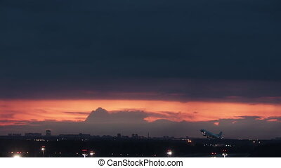 A poetic aircraft takeoff - on a red sky night background