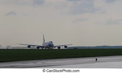 Takeoff run of Jumbo Jet. Cargo aircraft takes off from ...
