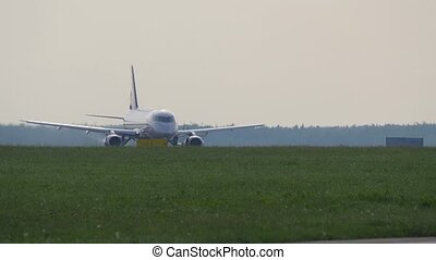 Takeoff run of passenger airplane. Airliner takes off from runway in Sheremetyevo