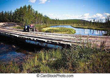 Taking a break on a creek crossing