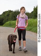 Taking a Labrador dog for a walk
