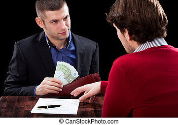 Taking a loan - A man and a banker in the process od giving...