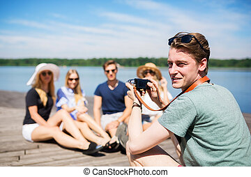 Taking a photo of friends