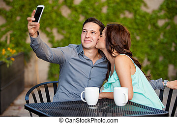 Taking a photo with my girlfriend - Young handsome man ...