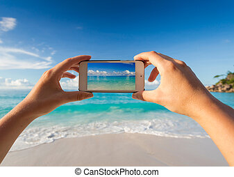 Taking a picture of the beach