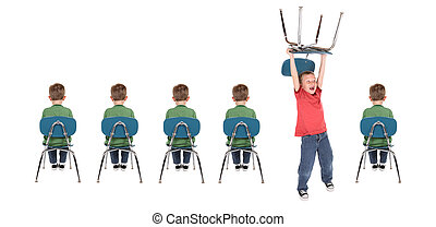 A row of boys sitting in school chairs while one boy acts out by holding his chair over his head.