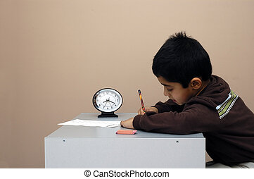 A child diligently taking a test on time