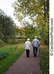 Taking A Walk - An elderly couple taking a walk in the woods...