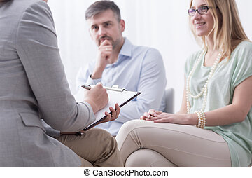 Taking advice at psychiatrist - Young woman and her husband...