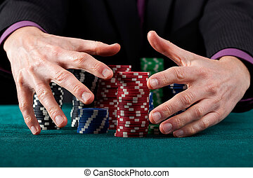 Taking all chips - A closeup of hands taking all of the...