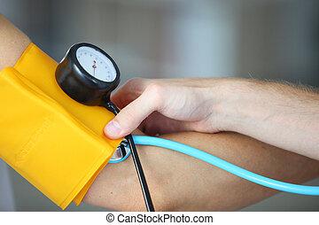 Taking blood pressure