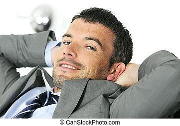 taking break - Attractive businessman is taking break from...