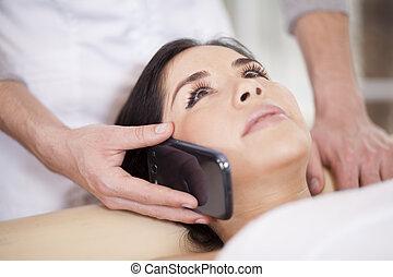 Taking call at a spa