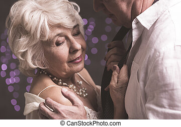 Taking care of close relation - Elder woman in man's embrace...