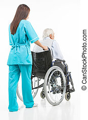 Taking care of seniors. Rear view of confident young nurse walking with patient sitting on the wheelchair while isolated on white