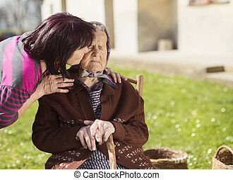Taking care - Senior woman with daughter taking care of her