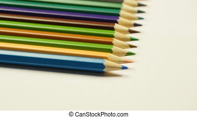 Taking colored pencil on white background