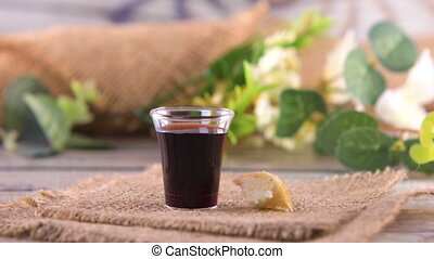 Taking communion concept - the wine and the bread symbols of Jesus Christ blood and body. Easter Passover and Lord Supper concept. Dolly shot