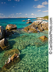 Massive boulders and crystal-clear waters on tropical island