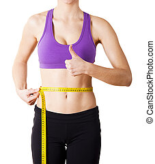 Taking measurements - Athletic young women taking...