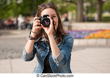 Taking memories. - Beautiful happy young brunette taking...