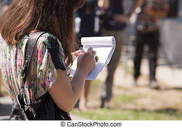 taking notes - Journalist is taking notes