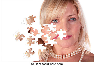 taking off puzzle from face of middleaged woman close-up, collage