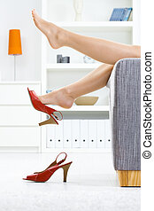 Taking off shoes - Woman legs in stockings, taking off high...