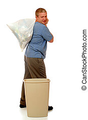 Taking Out the Trash - A man taking out the trash bag from a...