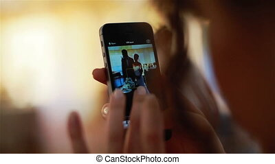 Taking phone picture of newlywed couple