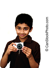 An handsome Indian kid taking photoa with a digital camera