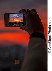 Taking photo at sunset